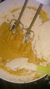 Blend the flour, oil, curd and milk