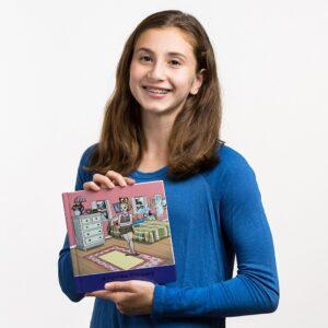 Rachel holding her Scribblitt book.
